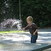 Estonian boy playing in the fountain