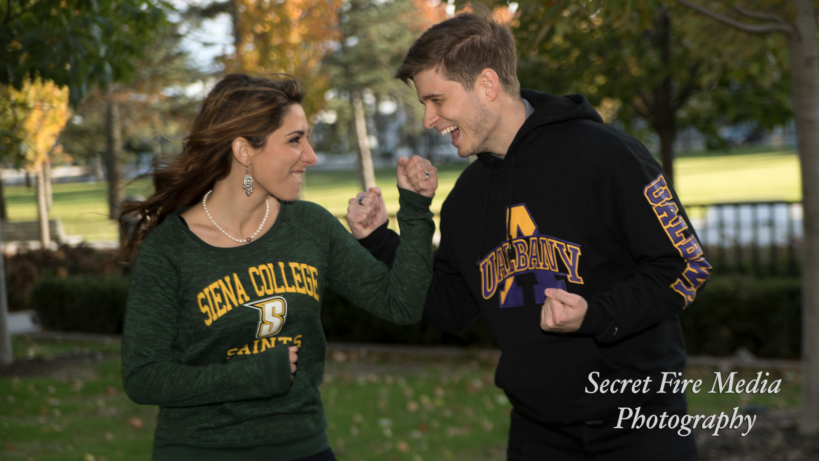 Bride and Groom wear Sienna Colleg and UAlbany sweaters at Their Albany Engagement Shoot at The University Of Albany