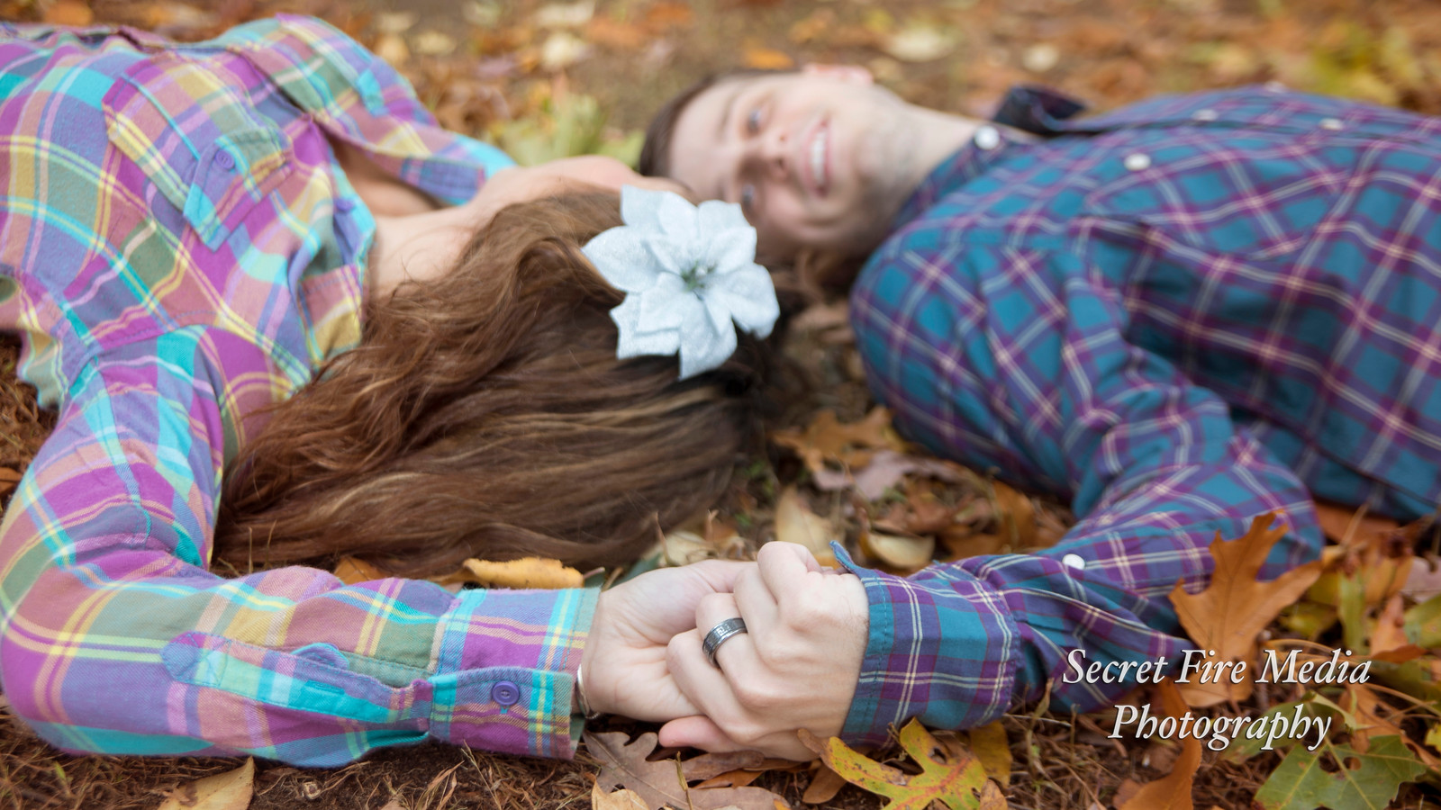 Bride and Groom lay on the grass at their Albany Enagement Shoot at The University Of Albany