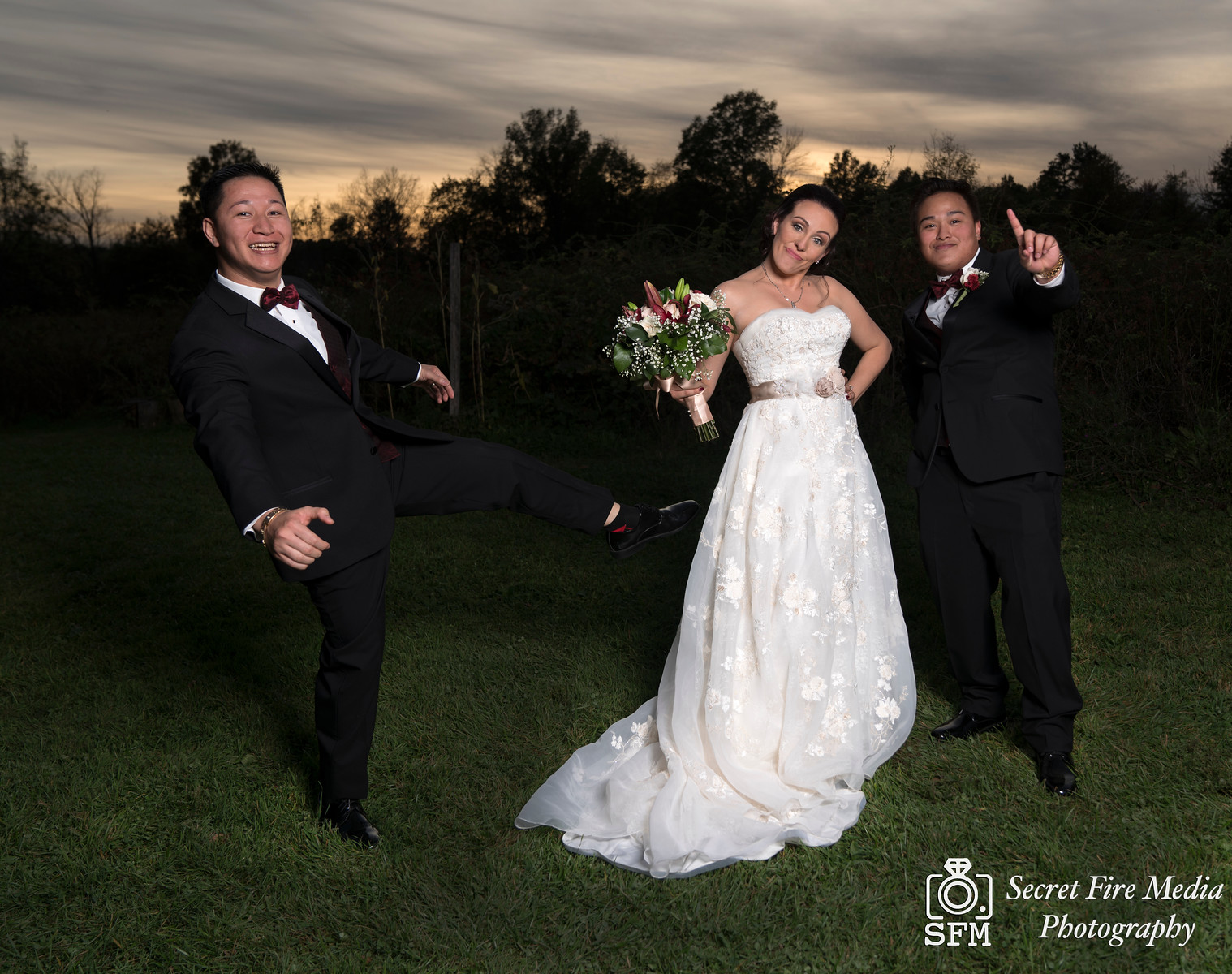 Bride poses with groomsmen at sunset for a Hudson Valley Wedding Photo At Lippincott Manor in Walkill New York