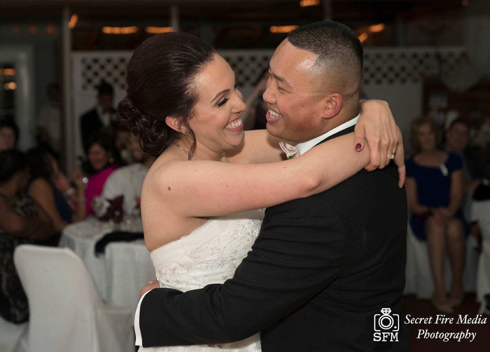 Bride and Groom smile during their first dance at a Hudson Valley Wedding At Lippincott Manor in Walkill New York