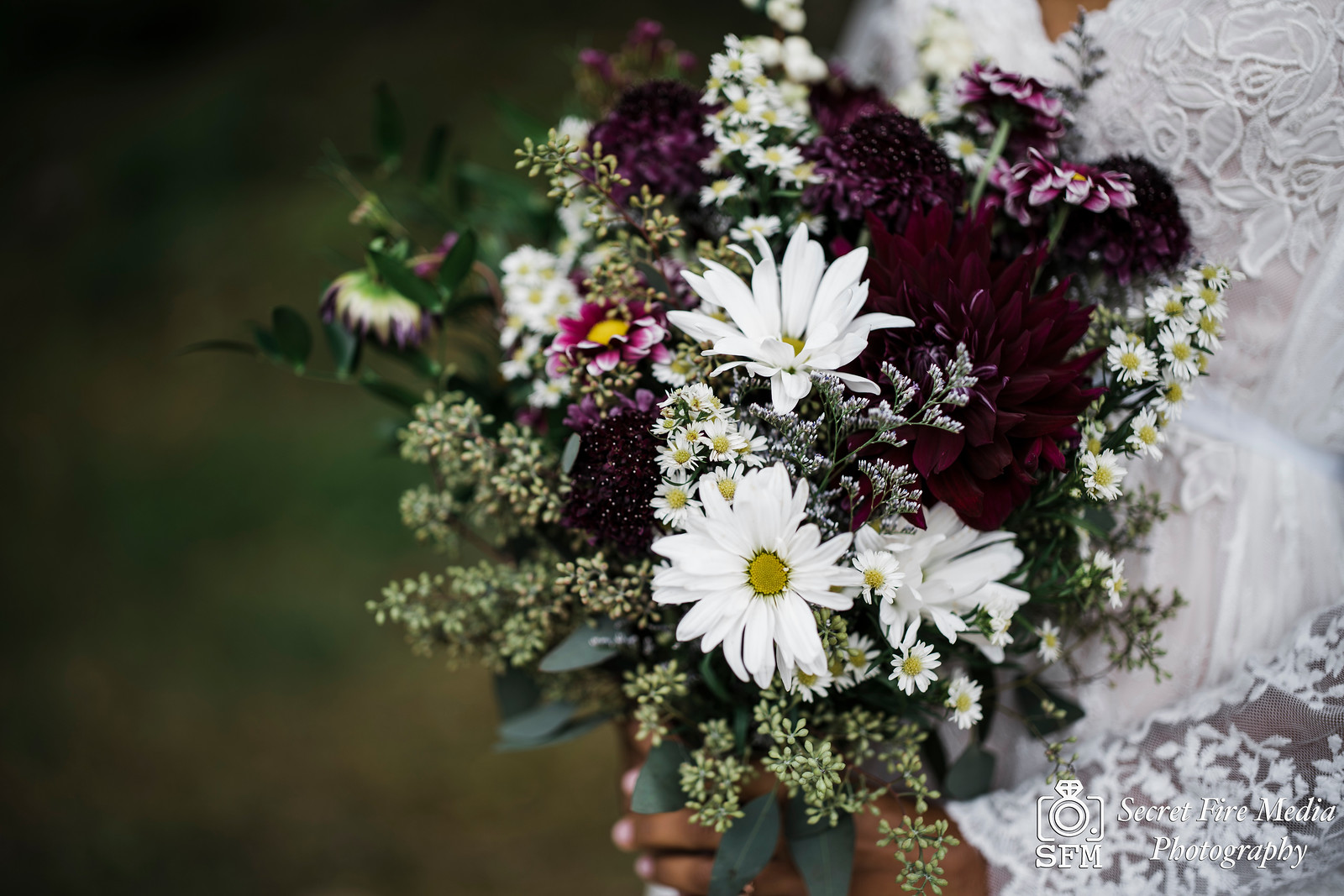 Brides bouquet by a lake at Blue Mountain Reservation before a Hudson Valley Wedding at The Dramatic Hall in Peekskill New York