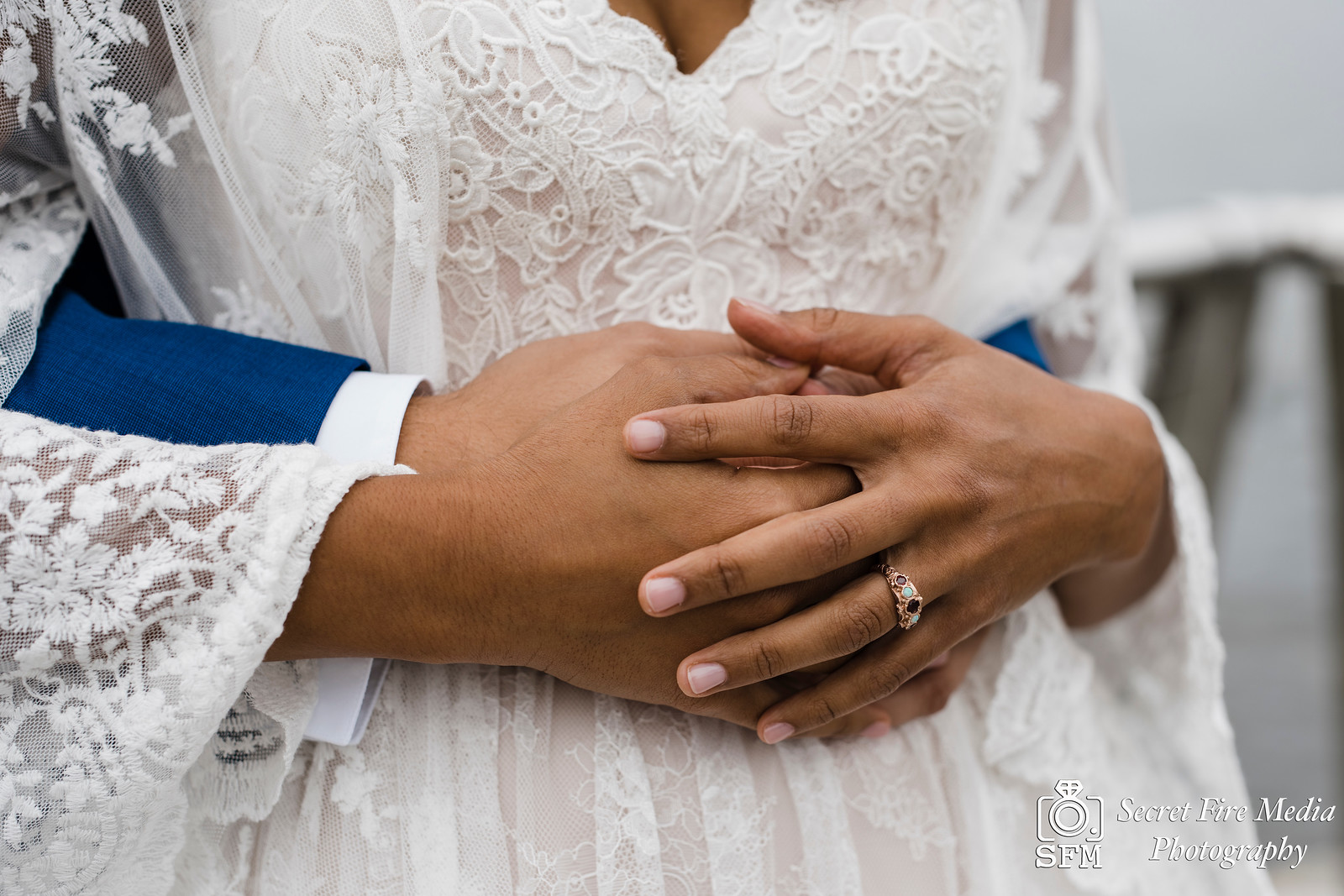 Bride and grooms hands and engagement ring at the Peekskill waterfront before a Hudson Valley Wedding at The Dramatic Hall in Peekskill New York