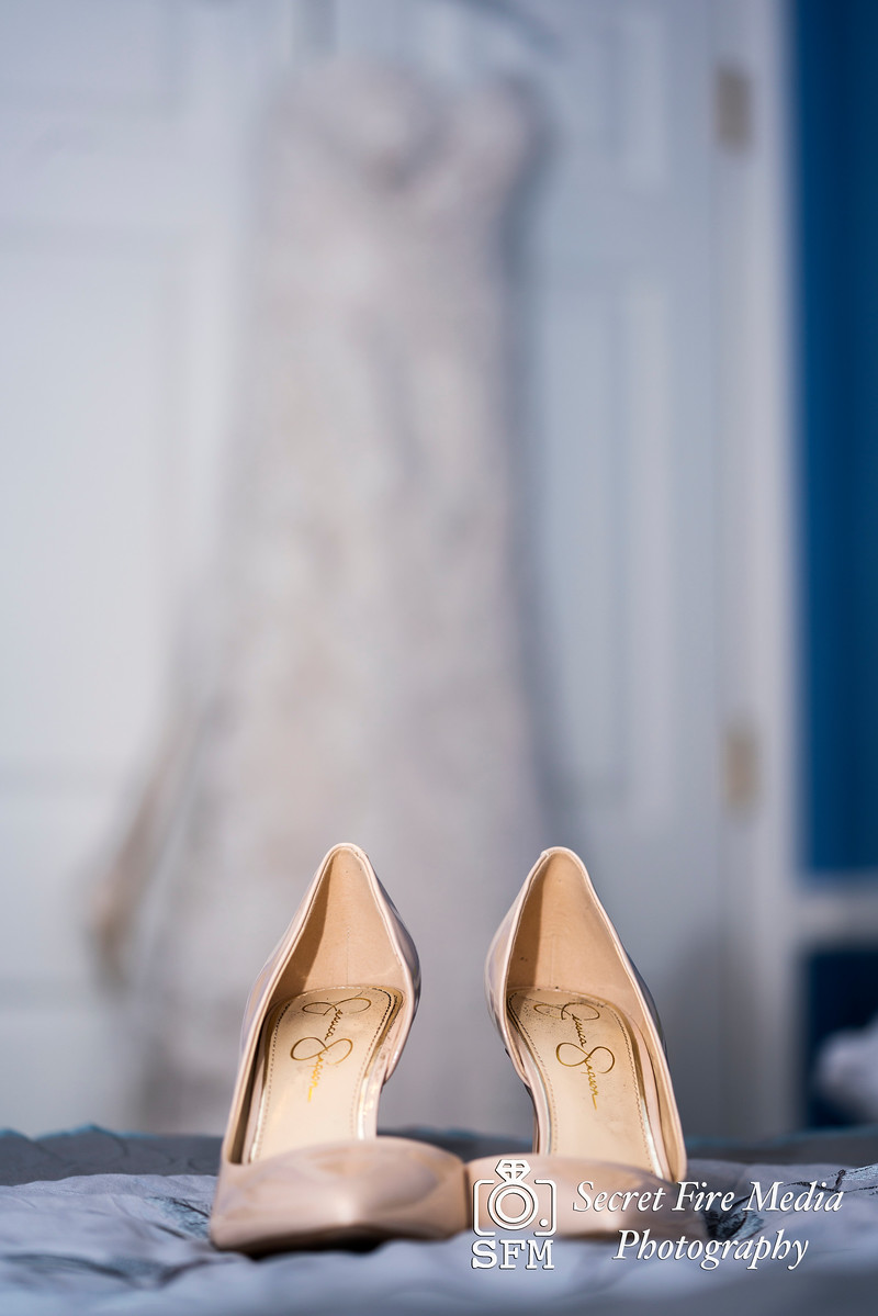 Brides wedding dress and shoes before her Hudson Valley Wedding At Links At Union Vale in New York