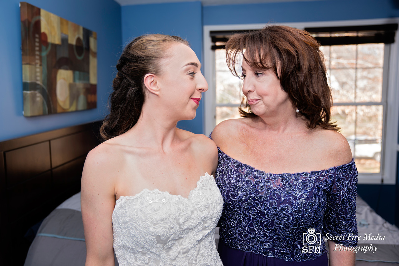 Bride poses for a photo with mother before her Hudson Valley Wedding At Links At Union Vale in New York