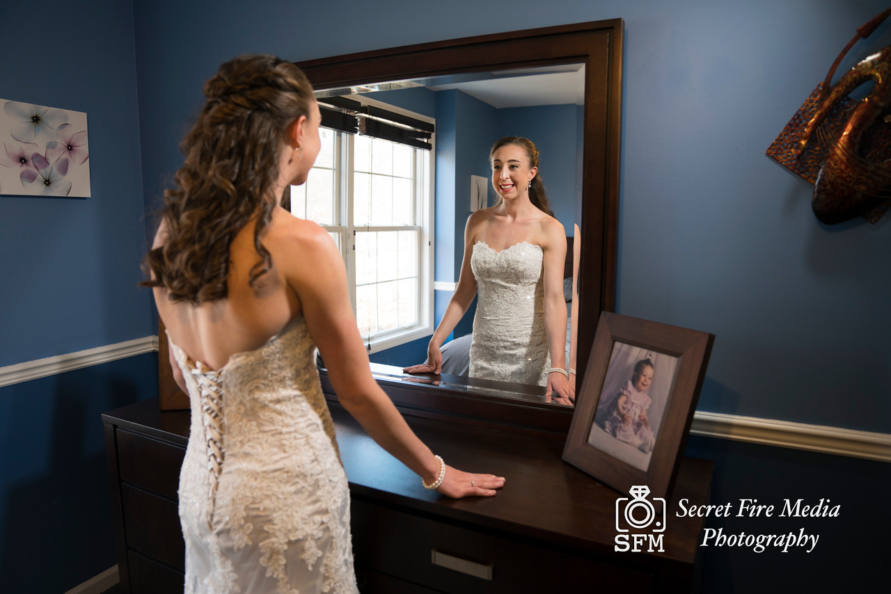 Bride poses while getting ready before her Hudson Valley Wedding At Links At Union Vale in New York