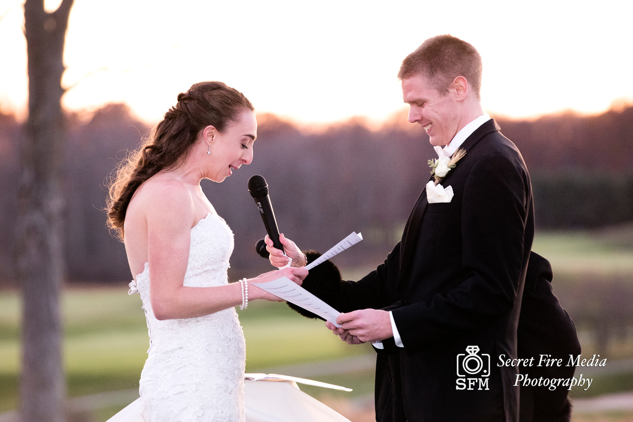 Groom reads vows to bride at Hudson Valley Wedding At Links At Union Vale in New York