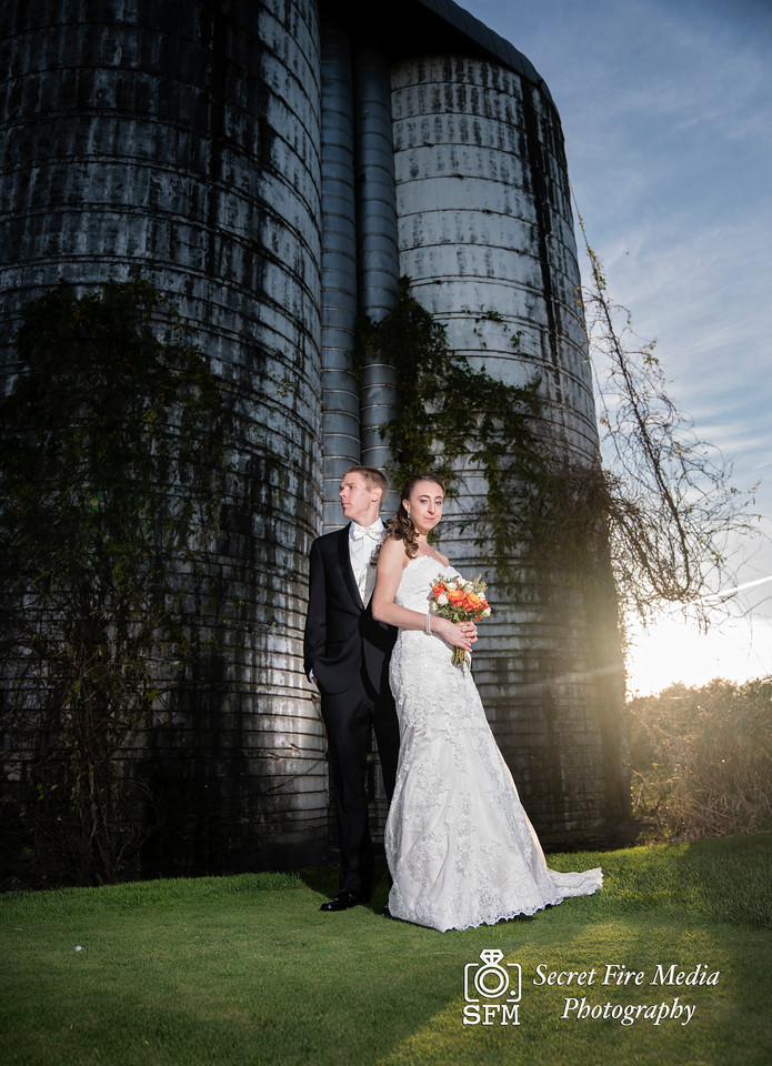 Bride and groom art photo by a silo before her Hudson Valley Wedding At Links At Union Vale in New York