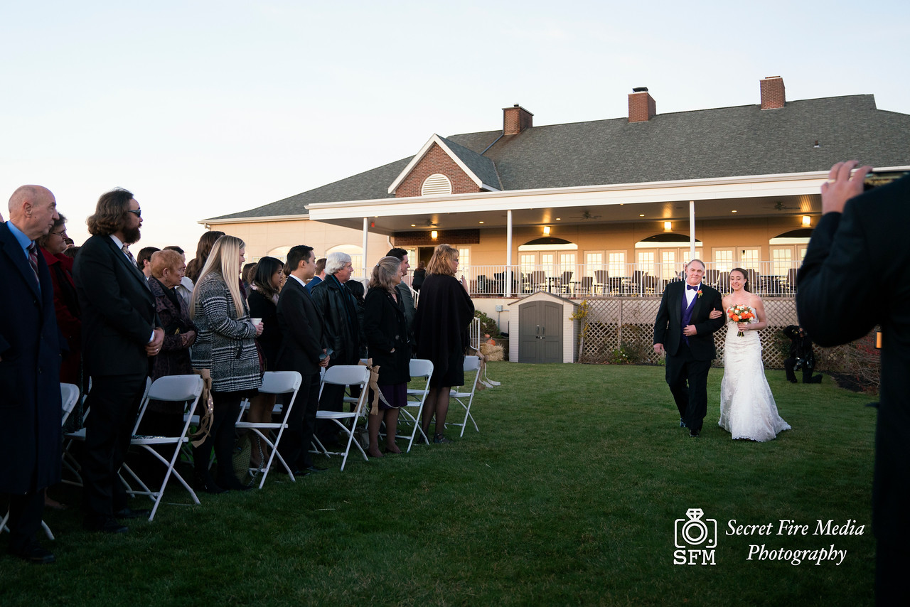 Bride walks down aisle at her Hudson Valley Wedding At Links At Union Vale in New York