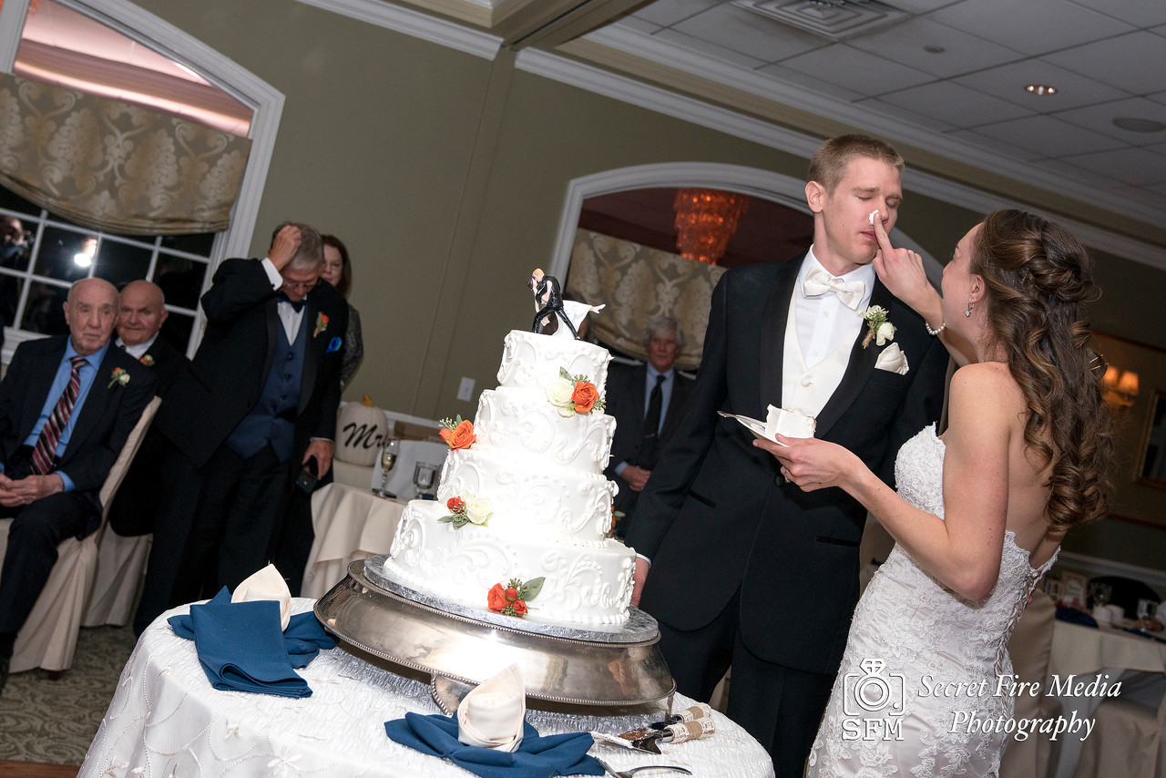 Bride gives Groom Wedding Cake at Hudson Valley Wedding At Links At Union Vale in New York
