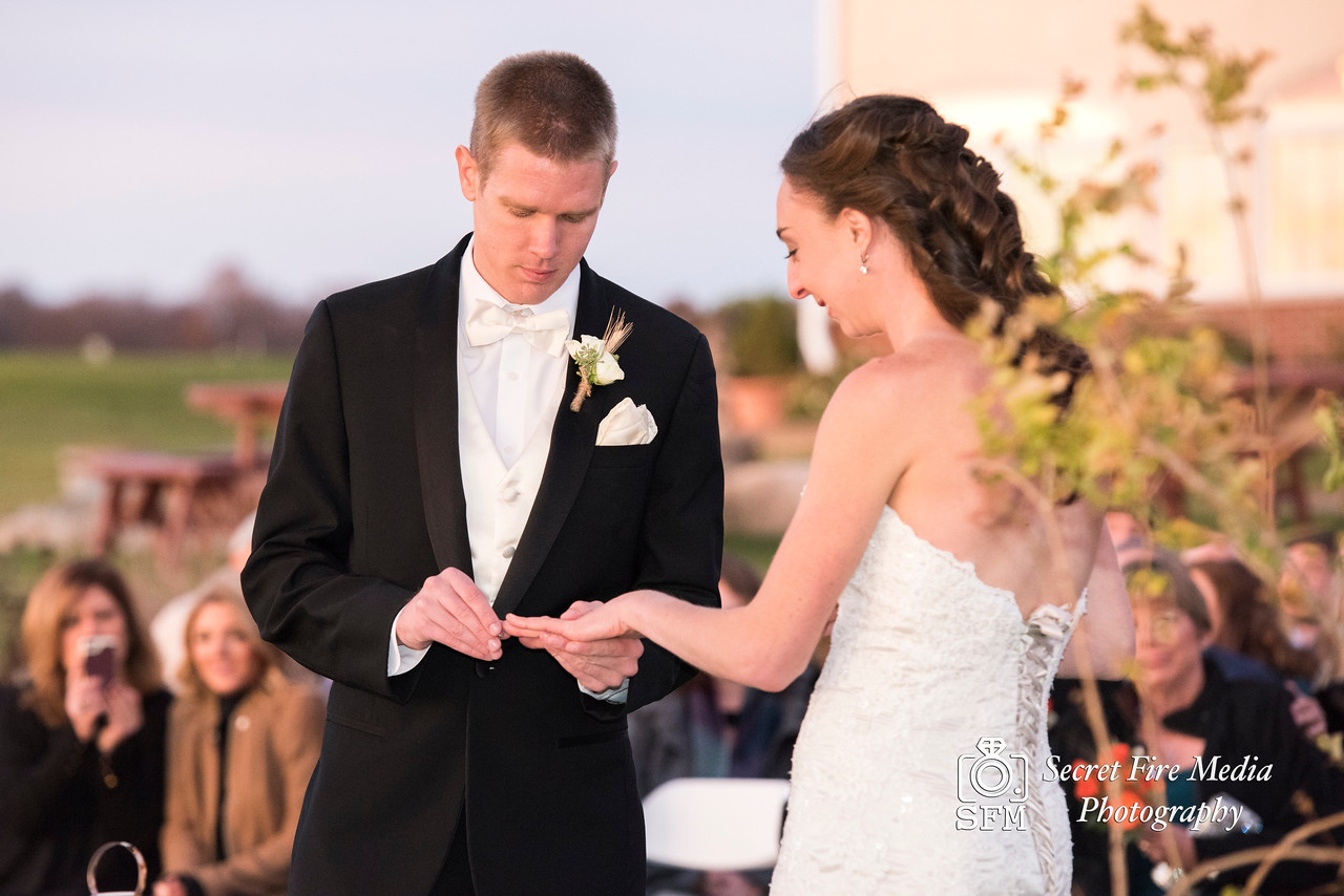 Groom puts ring on Bride bride at Hudson Valley Wedding At Links At Union Vale in New York