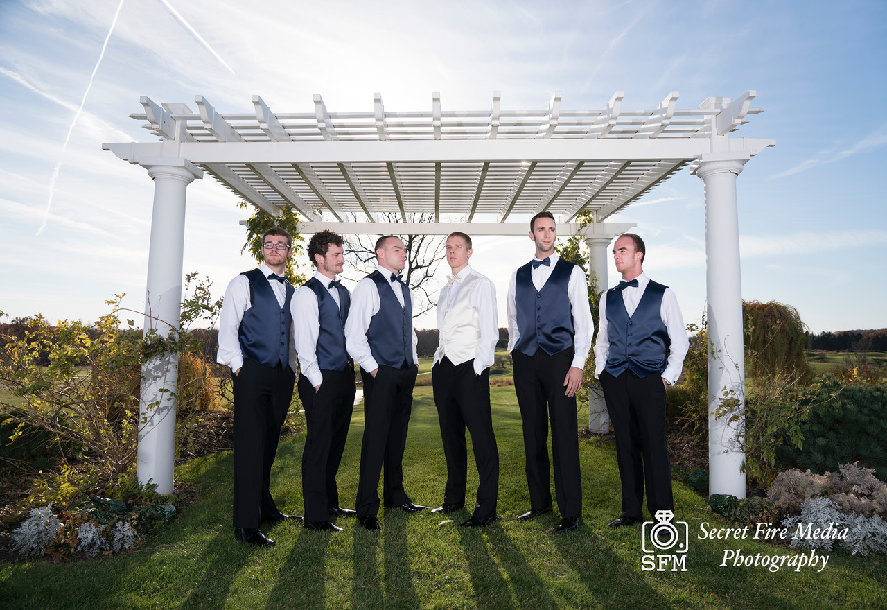 Groomsmen and Groom pose for a photo before her Hudson Valley Wedding At Links At Union Vale in New York