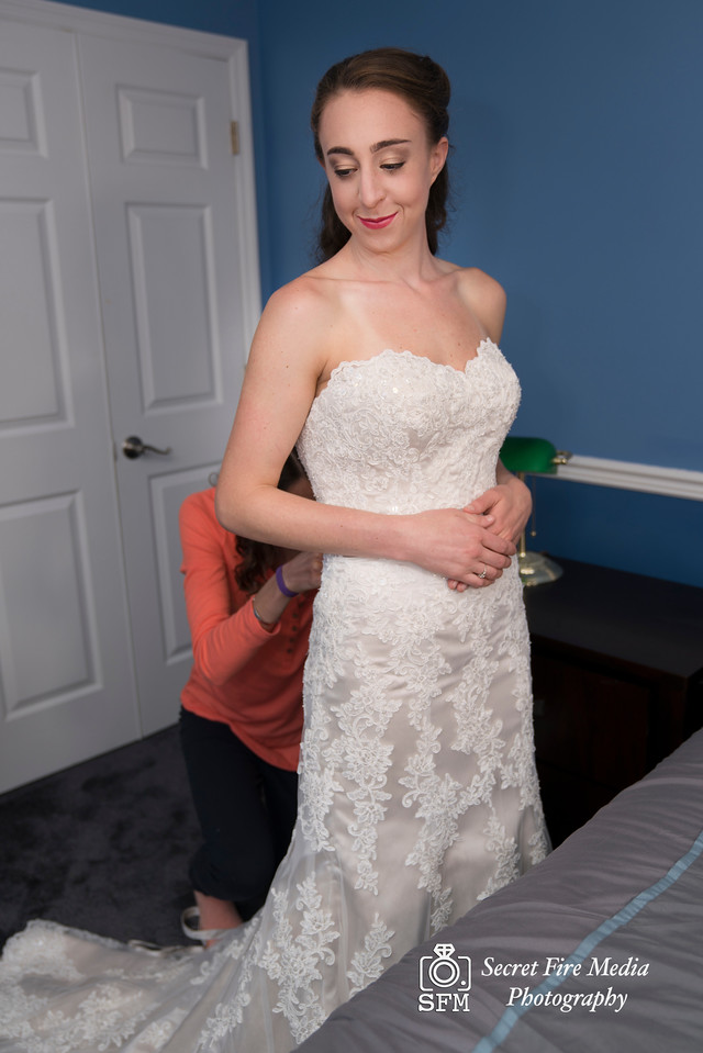 Bride gets ready before her Hudson Valley Wedding At Links At Union Vale in New York