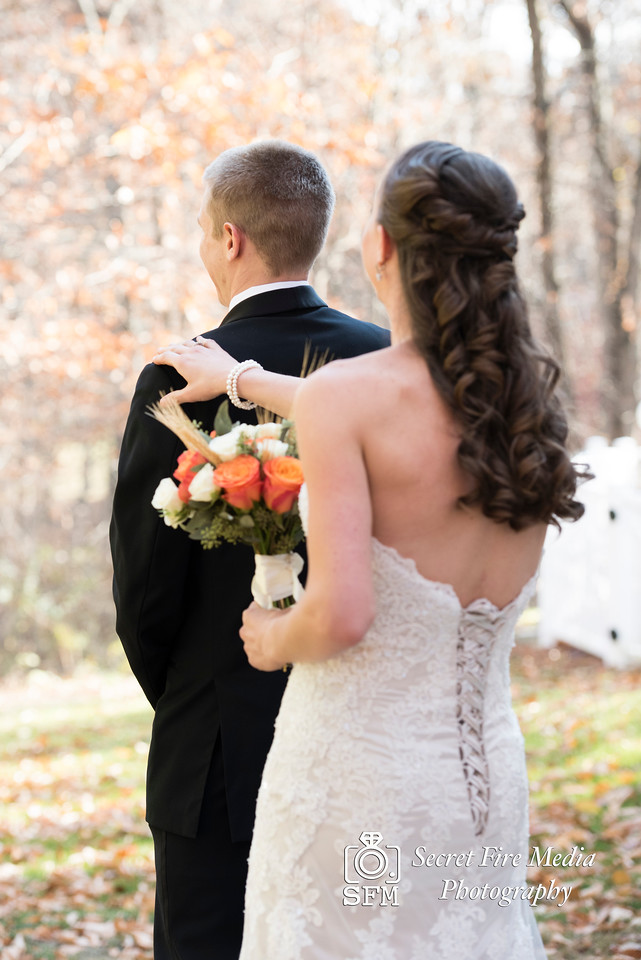 Bride taps grooms shoulder before her Hudson Valley Wedding At Links At Union Vale in New York