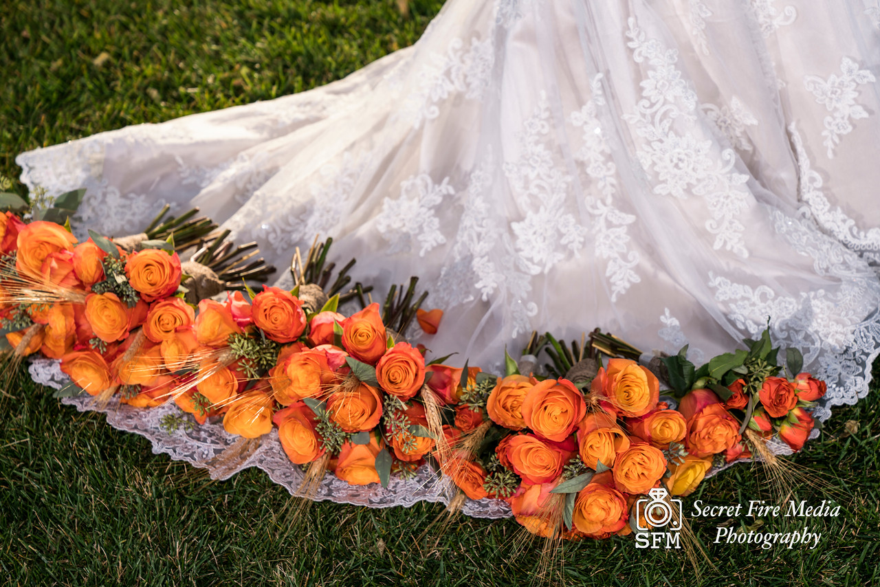 Brides dress and bouquets before her Hudson Valley Wedding At Links At Union Vale in New York