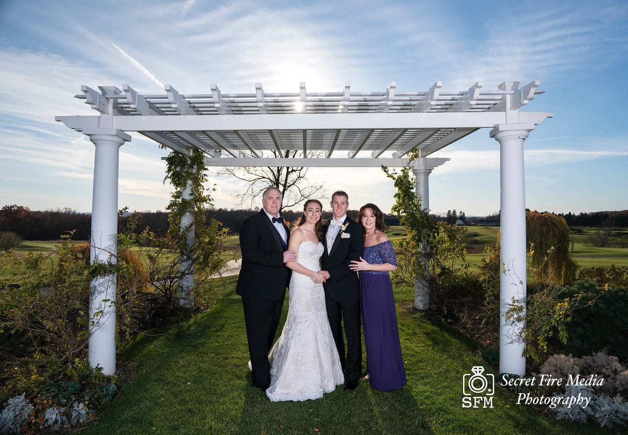 Bride poses with family before her Hudson Valley Wedding At Links At Union Vale in New York