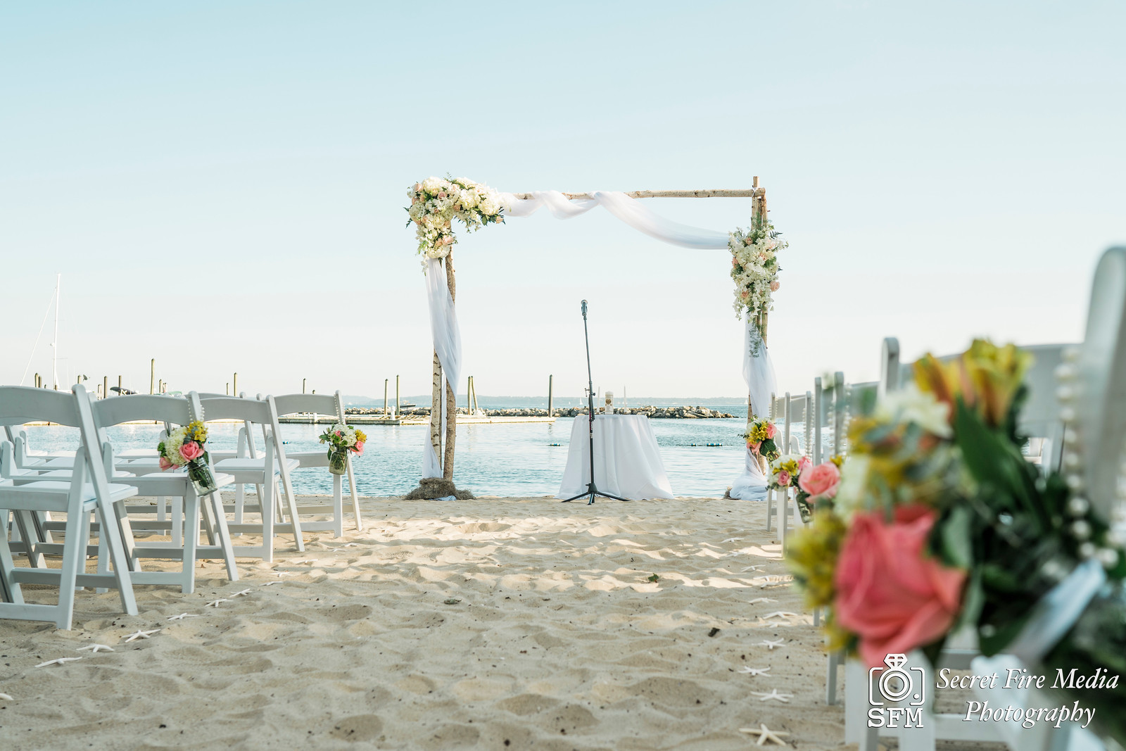 Ceremony on a beach at a Hudson Valley Wedding At Mamaroneck Beach and Yatch Club