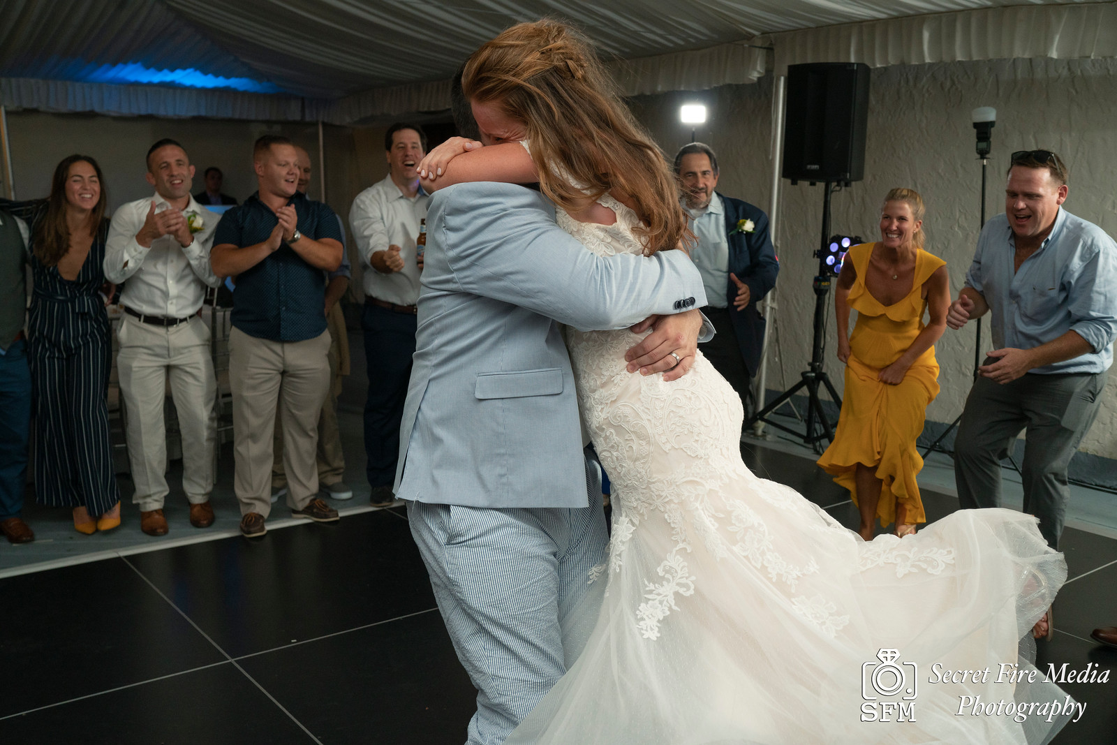 Groom twirls Bride during first dance at a Hudson Valley Wedding At Mamaroneck Beach and Yatch Club