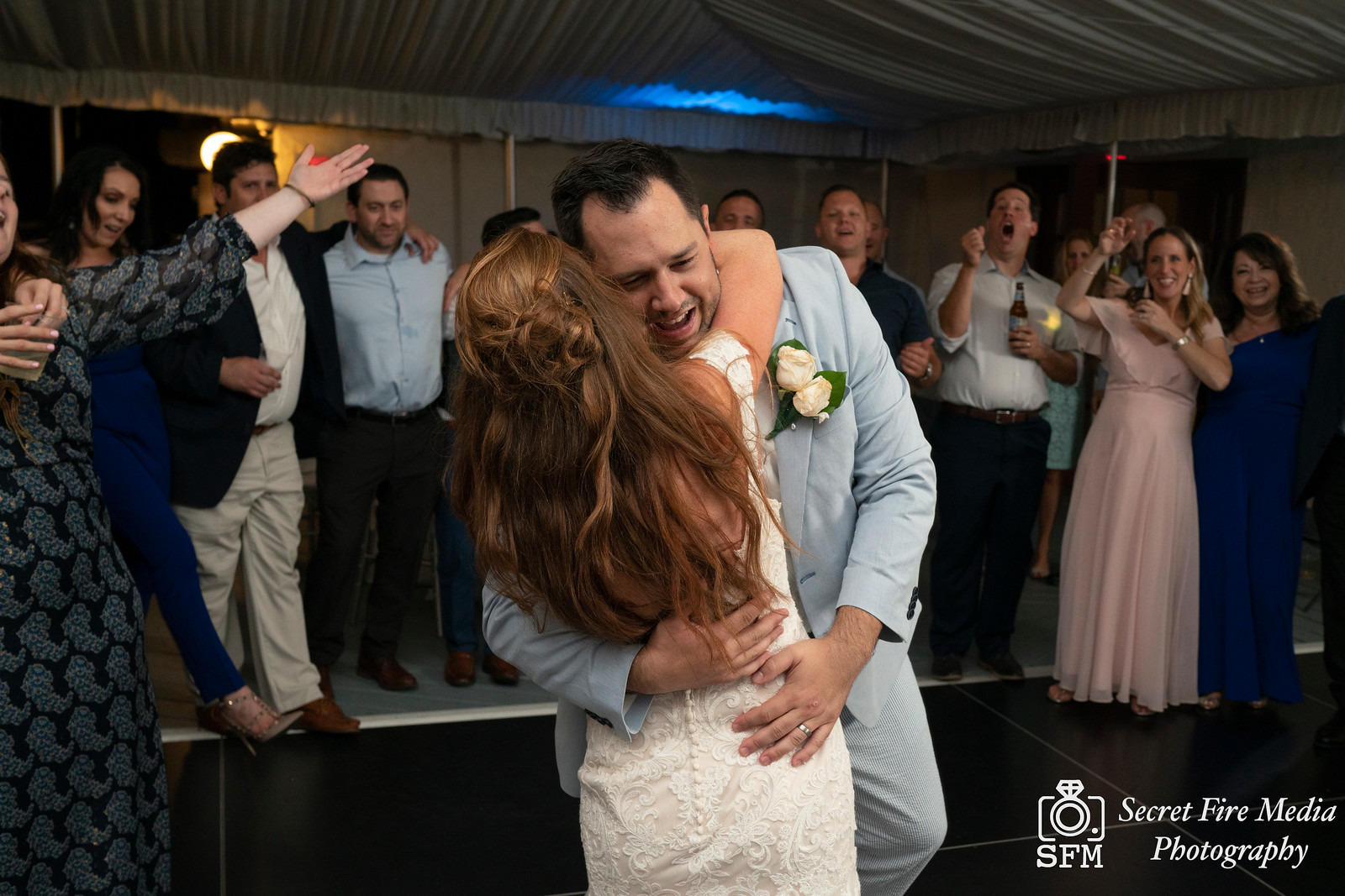 Bride and groom hug during first dance at a Hudson Valley Wedding At Mamaroneck Beach and Yatch Club