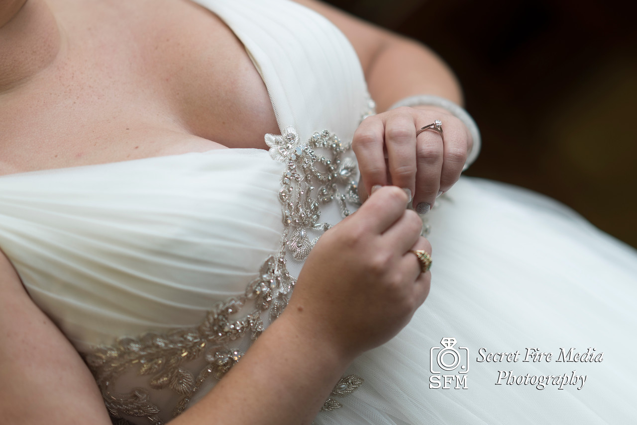 Bride posing for a wedding photo while getting ready for a Hudson Valley Wedding At Hunter Mountain in Hunter New York