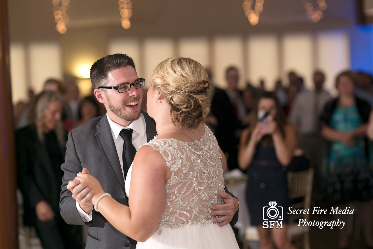 Groom smiles at bride during their first dance at a Hudson Valley Wedding At Hunter Mountain in Hunter New York