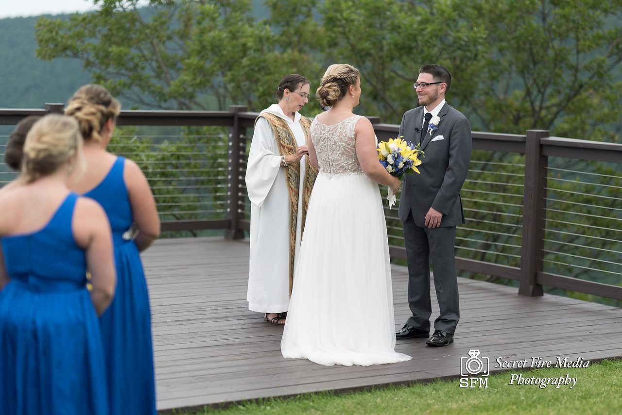 Groom looks at his bride during their ceremony at a Hudson Valley Wedding At Hunter Mountain in Hunter New York
