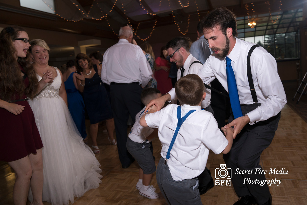 Wedding guests dance suring the reception at a Hudson Valley Wedding At Hunter Mountain in Hunter New York