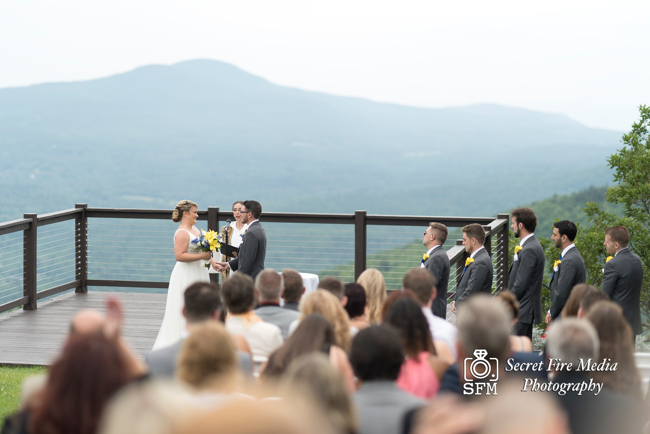 Bride smiles at groom during their ceremony at a Hudson Valley Wedding At Hunter Mountain in Hunter New York