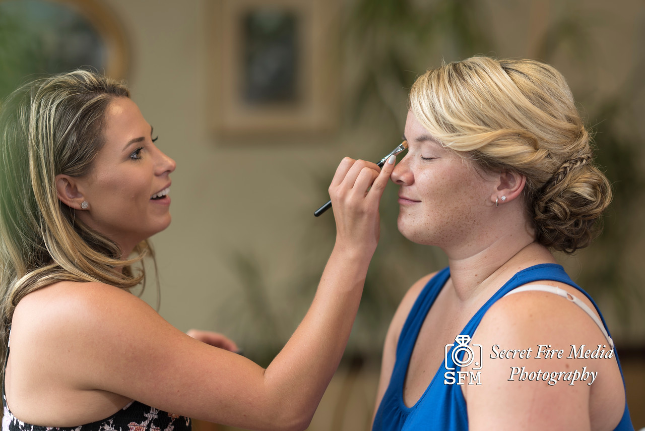 Bride getting make up done getting ready for her Hudson Valley Wedding At Hunter Mountain in Hunter New York