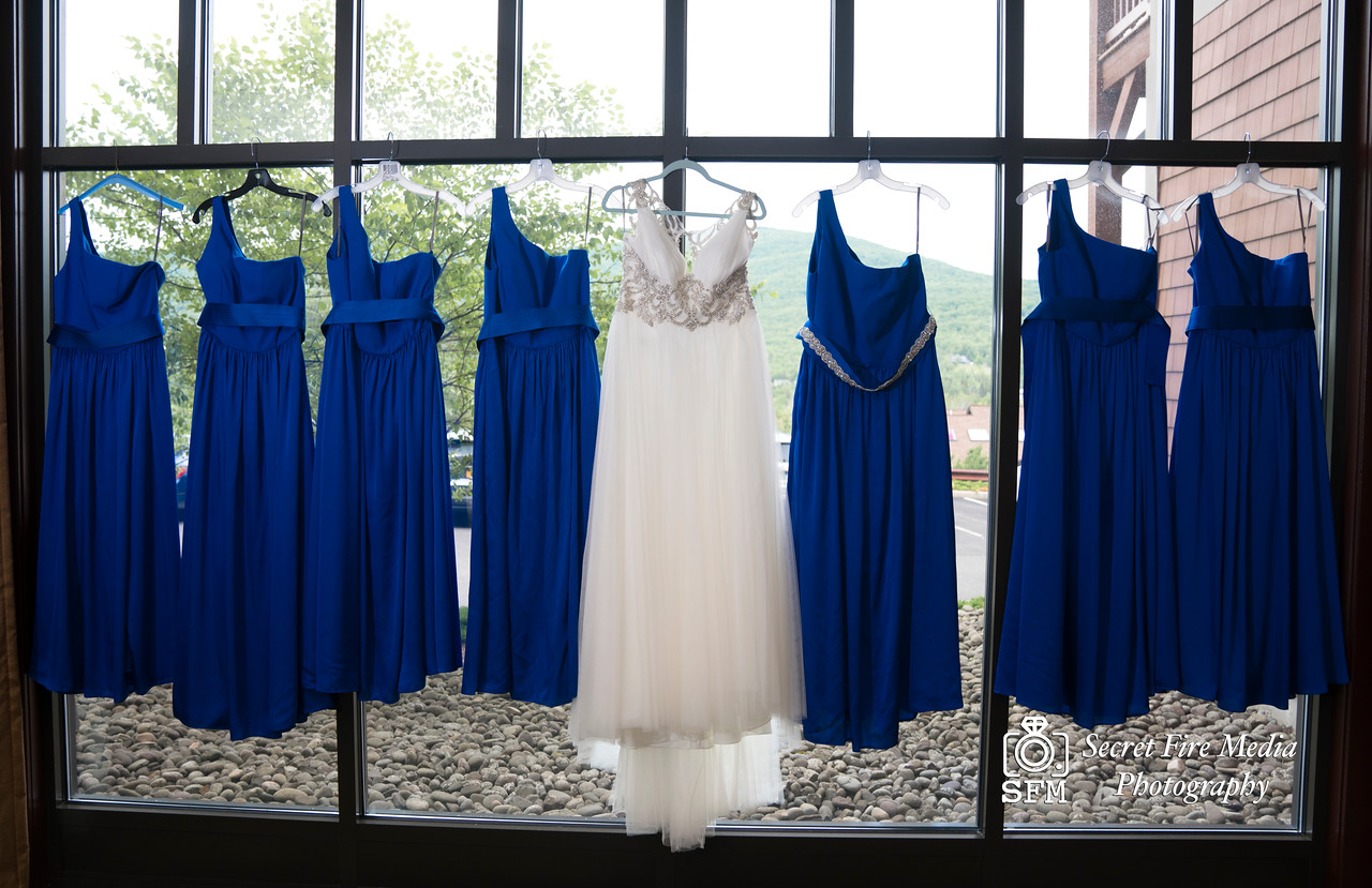 Bride and bridesmaids wedding dresses while getting ready for her Hudson Valley Wedding At Hunter Mountain in Hunter New York