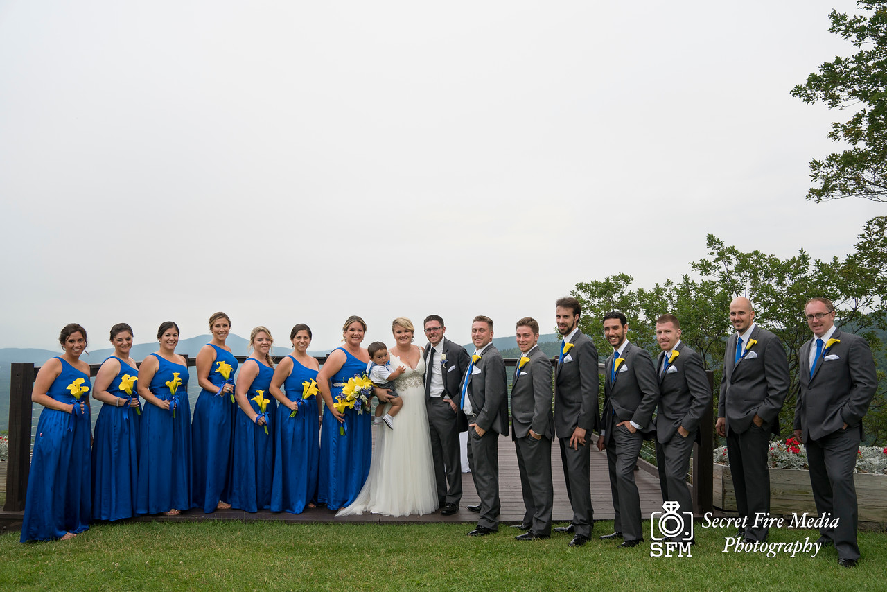 Bridal party poses for a photo at a Hudson Valley Wedding At Hunter Mountain in Hunter New York