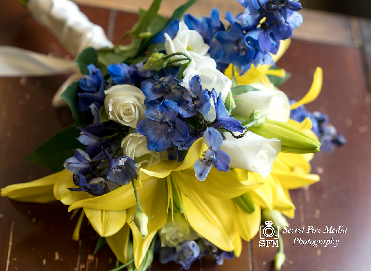 Brides bouquet on a table while getting ready for her Hudson Valley Wedding At Hunter Mountain in Hunter New York