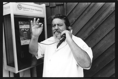 Captain Lou Albano using Holiday House phone booth. Bethany Boardwalk. 1993?