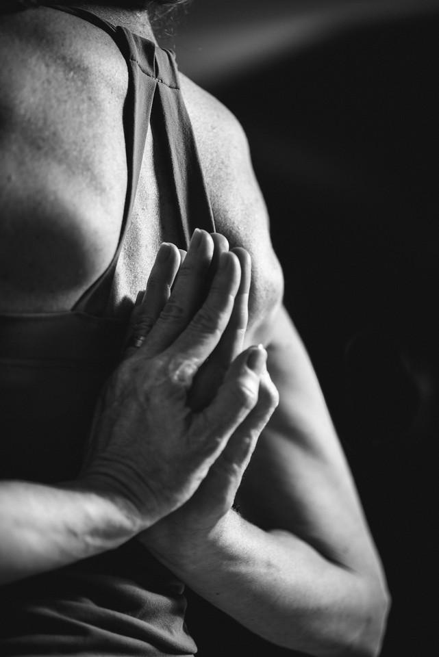 Hands Behind Heart Center
