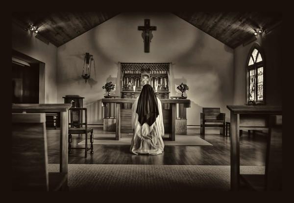 A  Nun in Adoration