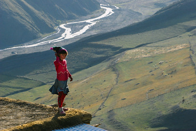 Girl on a roof, Xinaliq, Azerbaijan
