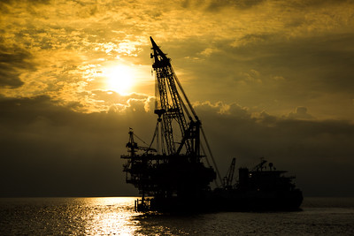 Crane barge in the sunset