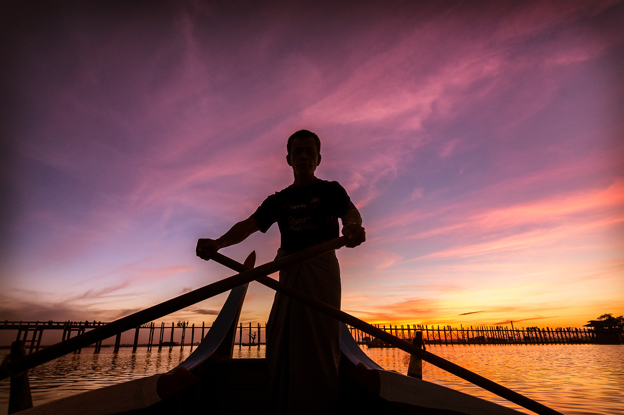 Sunset boat ride on Taungthaman Lake, approaching U Bein Bridge