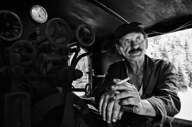 Yosife Ciubon conducts the steam engine near Viseu de Sus, Romania