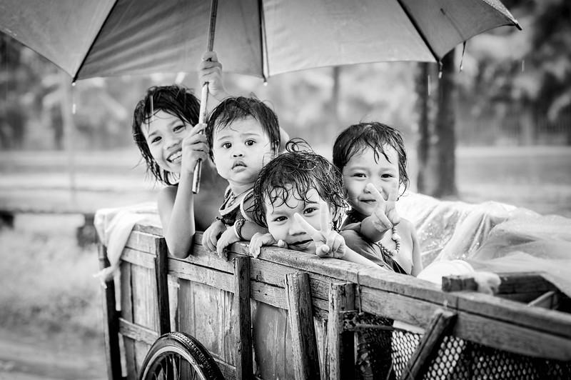 Four kids in trailer in Siem Reap, Cambodia