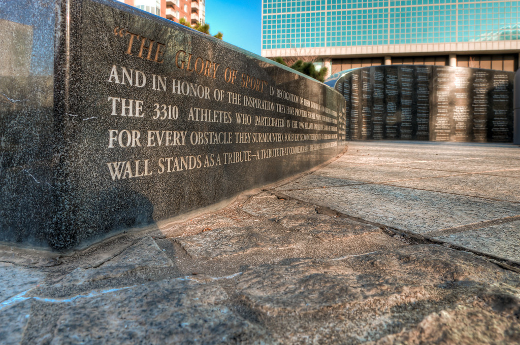 """<h3><strong>Today's Photo: For """"The Glory of Sport""""</strong></h3> While walking Centennial Olympic Park, I ran across many little statues, fountains and waterfalls tucked all around the park. I found this in an obscure corner and almost walked by it. There are so many other things going on around this area that it was almost missed. Just across the street was the World of Coke and also in this corner of the park was the kids playground equipment and the ice skating rink. The layout of this statue was just perfect for a shot close to the ground. I am still hurting from the contortionist position I had to get into for this shot.  Read more at the <a href=""""http://justshootingmemories.com"""">Daily Photography Blog</a> Just Shooting Memories!..."""