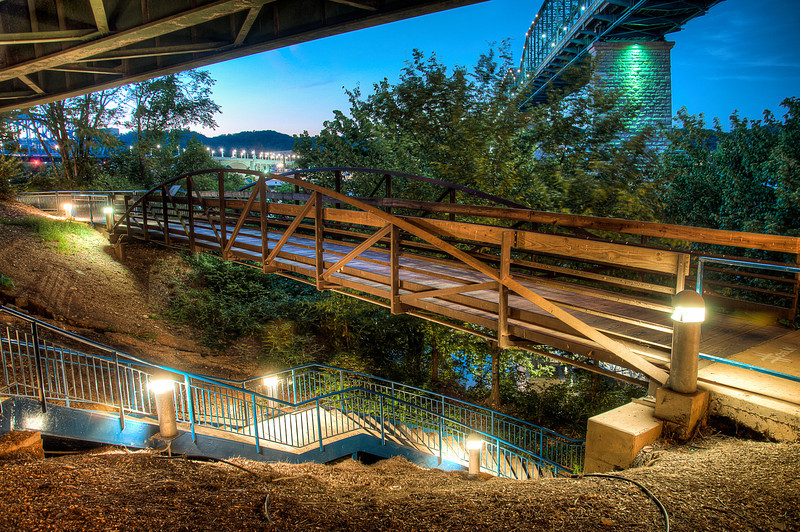 """<h3><strong>Today's Photo: Finding the Troll</strong></h3> I am continually amazed at Chattanooga. Nearly every time we go, I discover something new. This last time, I decided to walk down a really steep switch-back section of walking path from the Hunter Museum to the water front. At the bottom of the path, there was a coolamphitheaterthat sits under the pedestrian bridge. I ran into a guy that was playing one of thoseAustralianhorn type thing. It set the mood for finding this bridge just a short ways away. The eerie music had me expecting a troll to appear and begin challenging me with a riddle.  Read more at the <a href=""""http://justshootingmemories.com"""">Daily Photography Blog</a> Just Shooting Memories!..."""