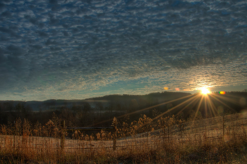 """<h3><strong>Today's Photo: Busy Sunrise</strong></h3> For the past few day's I have been able to be up and in a good place for the sunrise. It's a good thing day's are getting shorter, because I have gotten to see the sunset too. This shot was pretty cool. The way the road goes through here, it allows you to set up for the sunrise in one place, move 20 yards down the road and get it again. This was one of the final shots before I ran out of the time I wanted.  Read more at the <a href=""""http://justshootingmemories.com"""" rel=""""nofollow"""">Daily Photography Blog</a> Just Shooting Memories!..."""