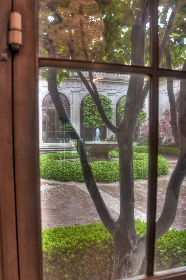 "<h3><strong>Today's Photo:  The Freer Window</strong></h3> This was just a parting shot as I left the Freer Gallery.  It was raining and I chickened out taking a shot from outside of the fountain.  However, I was able to capture the reflection of the ceiling in the entrance hall for this building which houses the <a title=""Asian History Museum"" href=""http://justshootingmemories.com/2011/05/24/asian-history-museum/"">Asian History Museum</a> of the Smithsonian Institute.  There are very few places where there is such a large concentration of museums and wonderful architecture than in the District of Columbia.  Read more at the <a href=""http://justshootingmemories.com"" rel=""nofollow"">Daily Photography Blog</a> Just Shooting Memories!..."