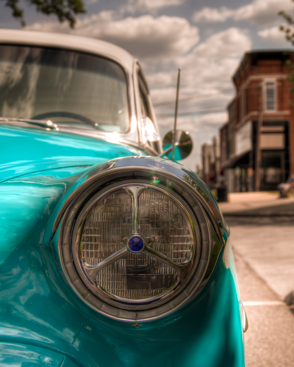 """<h3><strong>Today's Photo: 1953 Belair</strong></h3> I have been to several car shows over the last year or so. They have all had their exciting cars and the not so exciting cars. The one thing in common through all of them that I have found is that all the cars are unique. Typically I find one car that stands out to me. This happened to be one that I found at the car show in downtown Cartersville. I thought it was pretty cool looking and even had a hula girl in the back window. However, what stood out for me were the head lights. Someonedefinitelytook some time with this one.  Read more at the <a href=""""http://justshootingmemories.com"""">Daily Photography Blog</a> Just Shooting Memories!..."""