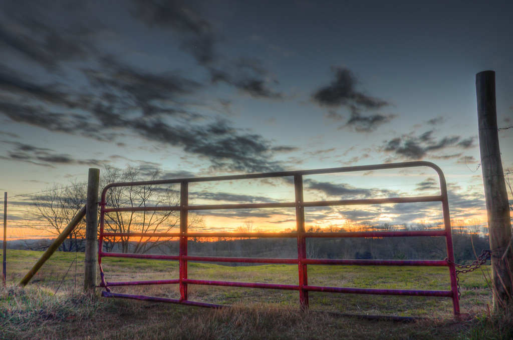 "<h3><strong>Today's Photo:  The Red Gate</strong></h3> The time around sunset offers so many photographic possibilities that, for me, they are endless.  I really like the opportunities to photograph cloud movement and mix it with long exposure photography.  It makes the clouds streak across the sky.  I shot this just after sunset and the clouds were racing across the sky.  I was able to make the over exposure at 30"" and then merge it using HDR.  I have found that a great way to portray movement in a photograph, is to take a long exposure in low light.  Read more at the <a href=""http://justshootingmemories.com"">Daily Photography Blog</a> Just Shooting Memories!..."