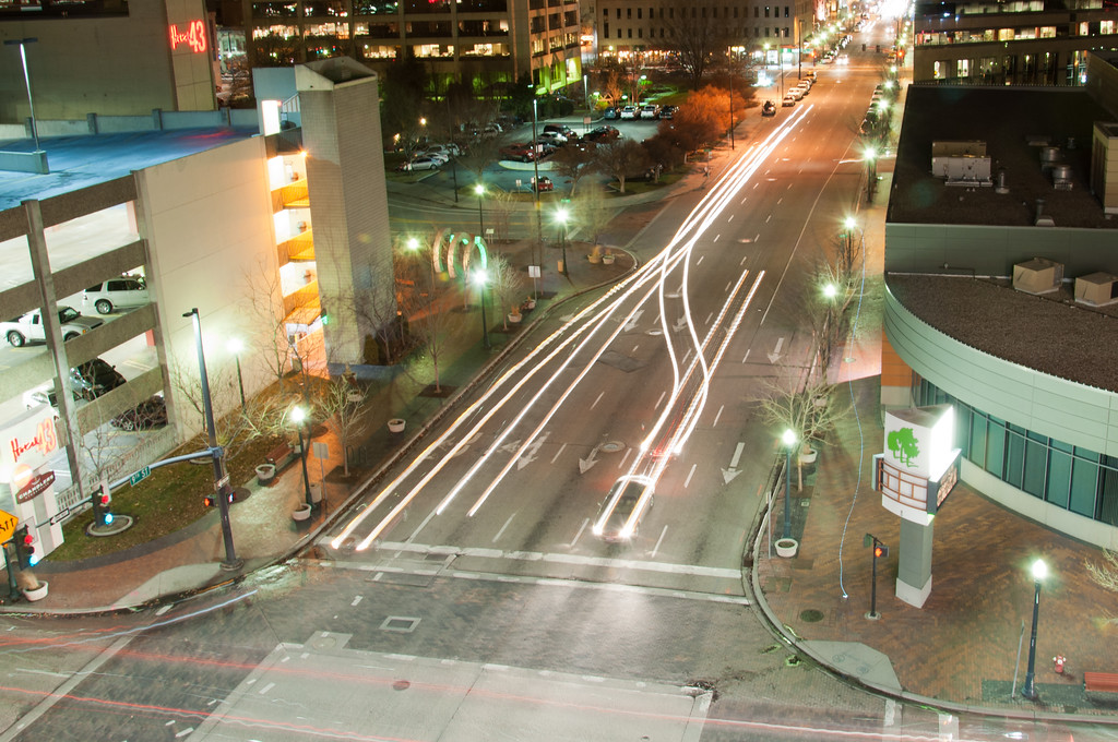 "<h3><strong>Today's Photo:  Light Trails</strong></h3> Over the years, I have looked at a lot of photos.  Many of my favorite happen to be light trails of traffic.  I am never in the right place late enough at night to get any good shots like this.  While in Boise, I spent a little while at the very top of an empty parking garage trying to figure out how to take these shots.  After a while, I was able to get a few that I thought were good.  This was my favorite.  I loved the completely random trails that were made.  You never knew what the photo would look like.  Read more at the <a href=""http://justshootingmemories.com"">Daily Photography Blog</a> Just Shooting Memories!..."