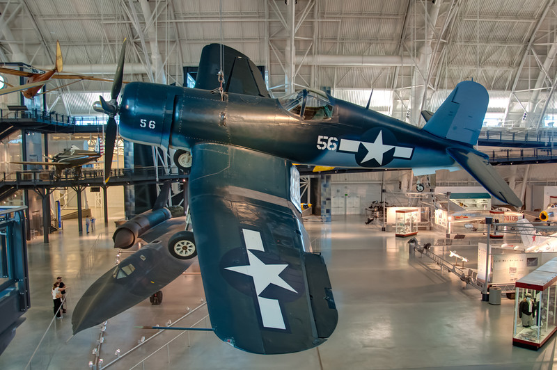 "Today, November 11, is Veterans Day in the United States.  I would like to say thank you to all the men and women that have maintained the freedom that allow me to post what I want. <h3><strong>Today's Photo:  Corsair</strong></h3> Ever since I was little, I have always been amazed with flight.  I loved to watch birds gliding through the air, not to mention watching airplanes and all other manner of flying things.  It is so hard to believe that just adjusting the way air flows over something can pull it into up into the air.  Even though they fly, airplanes are still heavy, so to see some of these large planes hanging from the ceiling is a feat.  It makes me wonder if they have ever had any accidents here.  This photo is of a Vought F4U Corsair.  What an amazing aircraft.  The speed and agility of this fighter made it a major factor in WWII.  You can find this and many other aircraft at the <a title=""Udvar-Hazy Center"" href=""http://www.nasm.si.edu/UdvarHazy/"" target=""_blank"">Smithsonian Air and Space Museum's Udar-Hazy Center</a>.  Read more at the <a href=""http://justshootingmemories.com"" rel=""nofollow"">Daily Photography Blog</a> Just Shooting Memories!..."