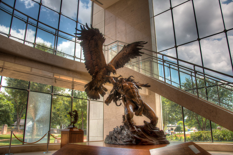 <h3><strong>Today's Photo:  The Eagle Hunter</strong></h3> Having museums near home is great.  You can go visit them when you want and don't have to cram a whole lot into a limited amount of time for one visit.  One of our local museums is the Booth Western Art museum.  It's almost like going back to the good old days of cowboys.  Everywhere are statues of Indians and cowboys, and then there were the paintings and statues depicting the American Civil War.  This is one of the more prominent statues in the museum.  With the religious significance of feathers, it does not surprise me that there was a statue depicting the struggle to capture a large bird of prey.