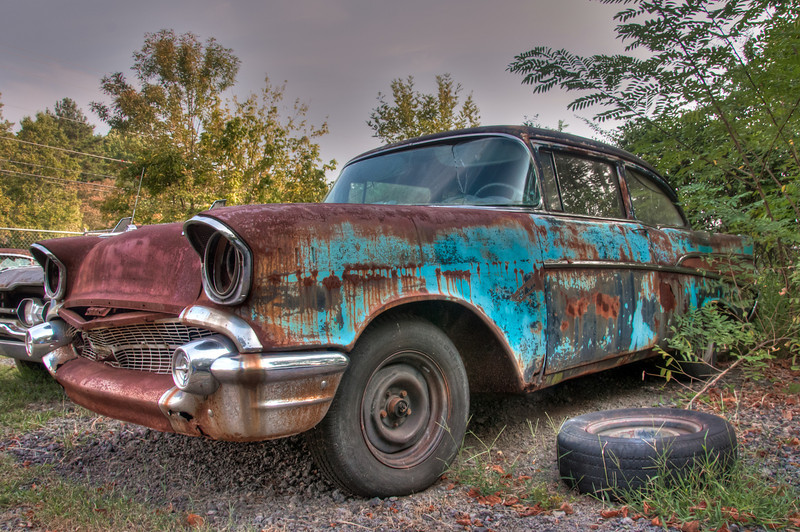 "<h3><strong>Today's Photo:  One Mans Junk</strong></h3> When I first saw Old Car City, I thought of the old saying ""One mans junk is another mans treasure.""  Old Car City is a junk yard.  What better place to find junk?  This car is a fine example of the junk that is all over the miles of trails.  I can't help but think of this car being used as the basis for a restoration project and the beauty that is waiting in the rusted out hull.  But you also have to think, it takes a very special person to see the treasure in this piece of junk just the way it is.  That goes for all the other junk stacked and abandoned all over this junkyard museum.  Read more at the <a href=""http://justshootingmemories.com"">Daily Photography Blog</a> Just Shooting Memories!..."